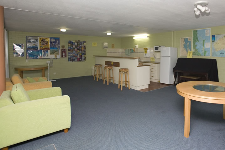 Recreation Room with kitchen, activity brochures, regional maps and a piano.